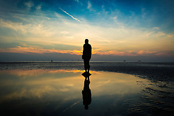 © Licensed to London News Pictures. 11/09/2015. Liverpool, UK.<br /> Picture shows the Antony Gormley sculptures 'Another place' on Crosby Beach near Liverpool. Photo credit: Andrew McCaren/LNP