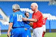 Tommy Charlton of England over 60's pats Giuliano Pittarella of Italy on the back at full time during the world's first Walking Football International match between England and Italy at the American Express Community Stadium, Brighton and Hove, England on 13 May 2018. Picture by Graham Hunt.