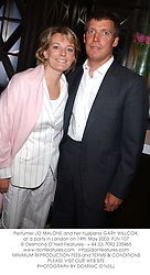 Perfumer JO MALONE and her husband GARY WILLCOX, at a party in London on 14th May 2003.	PJN 107