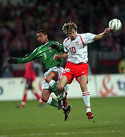 Photo. PIOTR HAWALEJ/Digitalsport<br /> Poland v Northern Ireland<br /> 30/03/2005<br /> 2006 World Cup Qualifier<br /> Poland's Miroslaw Szymkowiak and Northern Ireland's  Jeff Whitley battle for the ball