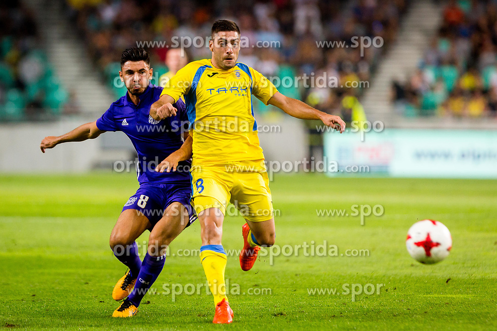 Matija Sirok of NK Domzale and Morgan Sanson of Olympic Marseille during football match between NK Domzale and Olympique de Marseille in First game of UEFA Europa League playoff round, on August 17, 2017 in SRC Stozice, Ljubljana, Slovenia. Photo by Ziga Zupan / Sportida