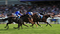 Jockey Martin Dwyer on board Zhui Feng (right) wins the Royal Hunt Cup during day two of Royal Ascot at Ascot Racecourse.