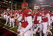 Nov 12, 2011; Fayetteville, AR, USA;  Arkansas Razorbacks cornerback Jerry Mitchell (38) shows off for the camera following a game against the Tennessee Volunteers at Donald W. Reynolds Razorback Stadium. Arkansas defeated Tennessee 49-7. Mandatory Credit: Beth Hall-US PRESSWIRE
