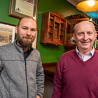 REPRO FREE<br /> Ronan Daly from Kinsale Crystal and carpenter Fachtna O'Mahony, Kinsale pictured at the official unveiling of a new Whiskey Cabinet in The Fifth Ward Bar at The White House Kinsale to commemorate the 20th anniversary of the Twinning of Kinsale and Newport, Rhode Island. <br /> Picture. John Allen<br /> <br /> TEXT OF SPEECH BY MICHAEL FRAWLEY JR<br /> Distinguished guests, members of Cork County & Bandon/Kinsale Municipal District Council & Members of Dáil & Seanad Éireann. Locals, visitors, friends and family<br /> This is our New Whiskey Cabinet in The Fifth Ward Bar at The White House Kinsale. It is to commemorate the 20th anniversary of the Twinning of Kinsale and Newport RI. <br /> <br /> I would like to start by welcoming you all and thanking you for braving the elements and making the trip in, although some of you didn't have to travel to far, which may be a good thing after the weekend you have just had.<br /> <br /> As you all know this weekend was our 43rd Gourmet festival which now coincides the Kinsale Newport Restaurant exchange, which in the absence of a town council has now become the Official Visit for our friends of old and the ones we have yet to meet  from Newport who are officially represented today by Rick O'Neill <br /> <br /> I am sure the big 20th anniversary will be commemorated officially at a later date, or in 2020 to mark the coming of age 21st Birthday. On that note I would like to thank the Municipal district council for hosting the dinner on Friday evening, it was a thoroughly enjoyable, While I am at it I would also like to thank Comans Beverages, Findlaters and Cassidys Wines for supplying refreshments for that evening. <br /> <br /> Since this is where it all began and the seeds were sown 22 years ago we thought it fitting that we should mark the 20th anniversary of the signing in some way and what better way than Whiskey, I happen to know that our friends across the pond and fond of Whiskey. <br /> In order to do s