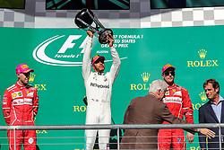 October 22, 2017 - Austin, Texas, U.S - Mercedes driver Lewis Hamilton (44) of Great Britain, Ferrari driver Kimi Raikkonen (7) of Finland and Ferrari driver Sebastian Vettel (5) of Germany on the podium after the Formula 1 United States Grand Prix race at the Circuit of the Americas race track in Austin,Texas. (Credit Image: © Dan Wozniak via ZUMA Wire)