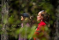 Cathy Paquette, Alex Dyer and Phoebe VanScoy-Giessler in meditation with Kate Kretschmer during her Trail Yoga class at Prescott Farm Environmental Education Center Saturday morning.   (Karen Bobotas/for the Laconia Daily Sun)