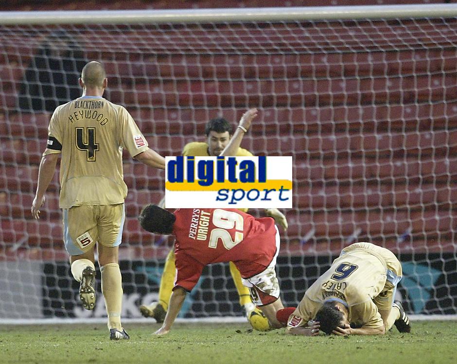 Photo: Aidan Ellis.<br /> Barnsley v Bristol City. Coca Cola League 1. 04/02/2006.<br /> Bristol's Louis Carey brings down Tommy Wright for the Barnsley penalty