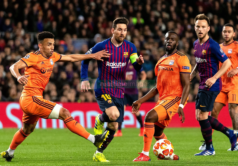 BARCELONA, March 14, 2019  Barcelona's Lionel Messi (2nd L) competes with Lyon's Fernando Marcal (1st L) and Tanguy NDombele (3rd L) during the UEFA Champions League match between Spanish team FC Barcelona and French team Lyon in Barcelona, Spain, on March 13, 2019. Barcelona won 5-1 and advanced to the quarterfinals. (Credit Image: © Joan Gosa/Xinhua via ZUMA Wire)