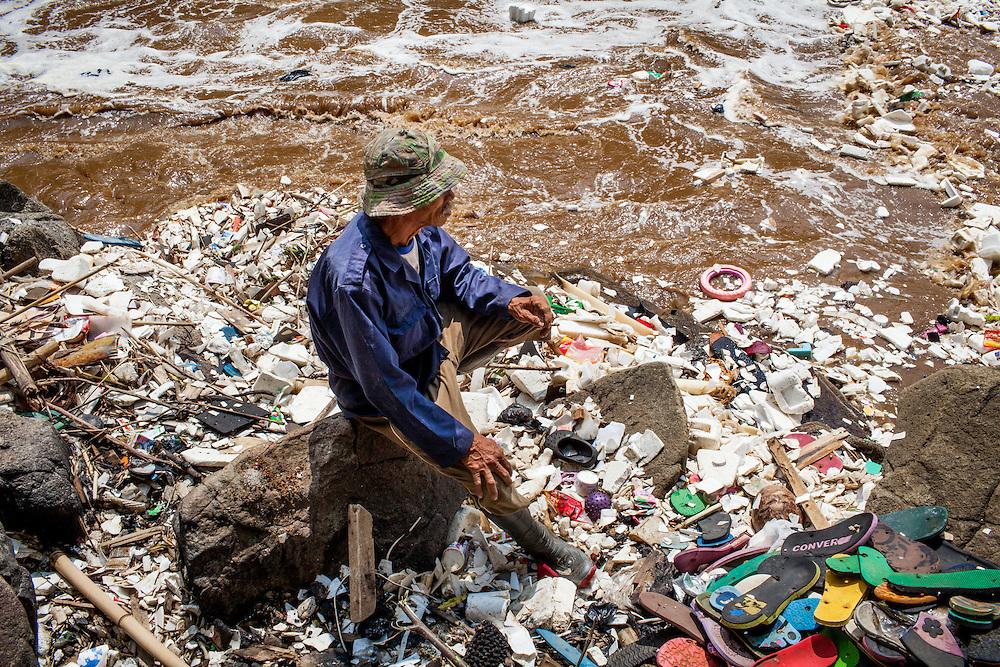 Pak Jumar, a village elder at Citarum river, downstream from Gistex toxic dump site. Jelegong Village, Kabupaten Bandung. ..Credit: Andri Tambunan for Greenpeace