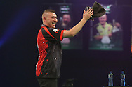 Nathan Aspinall all smiles despite his semi final defeat during the PDC Unibet Premier League darts at Marshall Arena, Milton Keynes, United Kingdom on 28 May 2021.