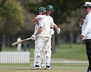 Bayley Wiggins of CD celebrates his half century with team mate Ben Wheeler. Canterbury vs. Central Districts Day 1, 1st round of the 2021-2022 Plunket Shield cricket competition at Hagley Oval, Christchurch, on Saturday 23rd October 2021.<br /> © Copyright Photo: Martin Hunter/ www.photosport.nz