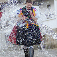 """Girls run as boys throw water at them as part of traditional Easter celebrations, during a media presentation in Holloko, 100 km (62 miles) east of Budapest, Hungary on April 14, 2011..Locals from the World Heritage village of Holloko, celebrate Easter with the traditional """"watering of the girls"""", a Hungarian tribal fertility ritual rooted in the area's pre-Christian past. ATTILA VOLGYI"""