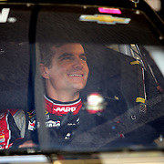 Driver Jeff Gordon sits in his car during the 56th Annual NASCAR Daytona 500 practice session at Daytona International Speedway on Saturday, February 22, 2014 in Daytona Beach, Florida.  (AP Photo/Alex Menendez)