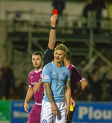 Forfar Athletic's Michael Travis brings down Arbroath's Michael McKenna for his second booking and a red card from Ref Euan Anderson. Forfar Athletic 2 v 3 Arbroath, Scottish Football League Division One played 8/12/2018 at Forfar Athletic's home ground, Station Park, Forfar.
