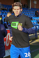 AFC Wimbledon defender Mads Bech Sorensen (26) warming up prior to kick off in Kick it out t shirt during the EFL Sky Bet League 1 match between AFC Wimbledon and Peterborough United at the Cherry Red Records Stadium, Kingston, England on 18 January 2020.