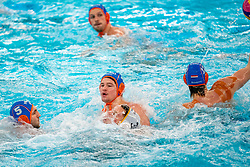 Guus Wolswinkel, Guus van IJperen of the Netherlands in action against Miroslav Perkovic of Montenegro during the Olympic qualifying tournament. The Dutch water polo players are on the hunt for a starting ticket for the Olympic Games on February 19, 2021 in Rotterdam