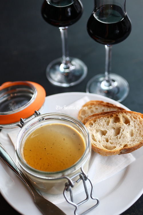 """Chicken-liver pate with sherry-vanilla gastrique with 1.5-ounce glasses of Bacarles """"Gran Vino Sanson,"""" from Spain.<br /> John Lok / The Seattle Times"""