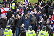 Facist supporters taunting the Anti Facist demonstrators from behind police lines in the port town of Dover, Kent. 30th January 2016
