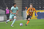 Gabriel Osho of Rochdale (3) and Hull City forward Keane Lewis-Potter (19) during the EFL Sky Bet League 1 match between Hull City and Rochdale at the KCOM Stadium, Kingston upon Hull, England on 2 March 2021.