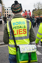 Uxbridge, UK. 16 November, 2019. A man wearing a vest reading 'Boris Pedals Lies' joins activists from FckBoris, a collective comprising many young women of colour, and other student-led groups holding a Kick Boris Out parade in Prime Minister Boris Johnson's constituency of Uxbridge and South Ruislip with aim of urging young, working-class and ethnic-minority voters to register to vote in the forthcoming general election whilst also protesting against the timing of an election during a vacation period which makes it difficult for university students to vote.