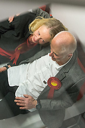 © Licensed to London News Pictures . 10/10/2014 . Heywood , UK . Labour candidate Liz McInnes with her partner Stee Duxbury shortly before the result is declared . The count at the Heywood and Middleton by-election , following the death of sitting MP Jim Dobbin . Photo credit : Joel Goodman/LNP