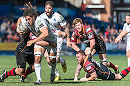 Josh Navidi (with the ball) of the Cardiff Blues charges as he is tackled by Boris Stankovich of the Newport Gwent Dragons. Guinness Pro12 rugby match, Cardiff Blues v Newport Gwent Dragons at the Cardiff Arms Park in Cardiff, South Wales on Sunday 17th April 2016.<br /> pic by Simon Latham, Andrew Orchard sports photography.