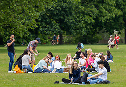 Licensed to London News Pictures. 29/05/2021. London, UK. Picnickers finally get to enjoy the warm weather after weeks of rain in Hyde Park, London. The Met Office have forecast warm weather and sunshine for the South East and London over the Bank Holiday weekend with temperatures predicted to hit up to 25c on Monday. Photo credit: Alex Lentati/LNP