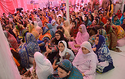 June 17, 2017 - Lahore, Punjab, Pakistan - Indian and Pakistani Sikh pilgrims  perform rituals in connection with the 411th death anniversary of Guru Arjan Dev Ji, the fifth of the eleven Sikh gurus at Gurdwara Dera Sahib in Lahore. According to Sikhism, the event is also called Shaheedi Jor Mela or Shaheedi Purab of Guru Arjan Dev Ji. (Credit Image: © Rana Sajid Hussain/Pacific Press via ZUMA Wire)