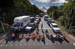 © Licensed to London News Pictures. 29/09/2021. Swanley, UK. Traffic backs up as Insulate Britain activists block the road near to junction 3 of the M25 motorway near Swanley for the second time today. 11 members of the campaign group were detained at the same junction earlier today. This is the seventh time in just over two weeks that activists have disrupted traffic on London's orbital motorway despite the government being granted a temporary High Court Injucntion banning the group from protesting on the M25. 50 protesters who were detained after Monday's protest, on junction 14 of the M25 at Heathrow, were released. Photo credit: Peter Macdiarmid/LNP