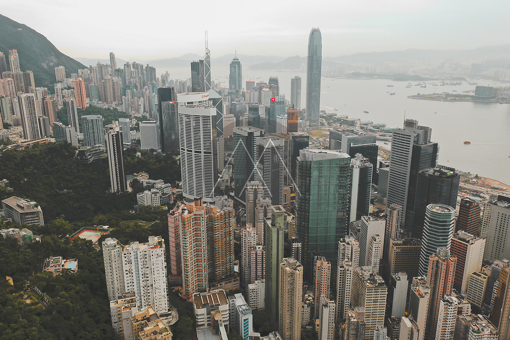 Aerial view of Hong Kong's iconic skyline with colourful apartments near the ocean, Hong Kong island.