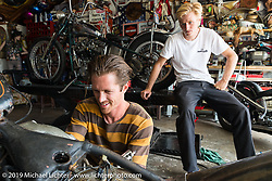 Cycle Zombies' Chase Stopnik works in Scotty's garage as Taylor looks on. Huntington Beach, CA. USA. June 29, 2015.  Photography ©2015 Michael Lichter.