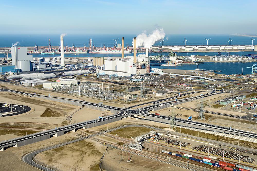 Nederland, Zuid-Holland, Rotterdam, 18-02-2015; Tweede Maasvlakte (MV2). Europaweg en Emplacement Maasvlakte West (Rail Terminal West). Aan het water van de Hartelhaven het Emplacement Maasvlakte Oost. In beheer bij Keyrail, exploitant Betuweroute. Zicht op de eleckrticiteitscentrales van E.ON., APM Terminals Rotterdam, ECT.<br /> <br /> Emplacement Maasvlakte West (West Rail Terminal) and  next to the Hartelharbour  the Emplacement Maasvlakte East. Managed by Keyrail, operator Betuweroute.<br /> <br /> luchtfoto (toeslag op standard tarieven);<br /> aerial photo (additional fee required);<br /> copyright foto/photo Siebe Swart