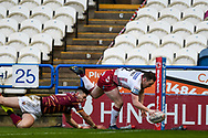 TRY! Liam Marshall (2) of Wigan Warriors scores a try and makes it 16-10 to Wigan Warriors during the Betfred Super League match between Huddersfield Giants and Wigan Warriors at the John Smiths Stadium, Huddersfield, England on 1 March 2020.