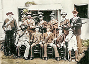 Machine colourised image of a Boer Farmer Of The Transvaal And His Ten Sons Ready For War From the Book '  Britain across the seas : Africa : a history and description of the British Empire in Africa ' by Johnston, Harry Hamilton, Sir, 1858-1927 Published in 1910 in London by National Society's Depository