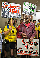 Robert Taylor and Cindy Russo with the Coalition Against Death Alley protesting in the  hallway outside of LABI's office in downtown Baton Rouge, Louisiana, on October 30, the last day of the two week environmental justice protest event.