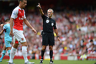 Referee Martin Atkinson in action.  Barclays Premier League, Arsenal v West Ham Utd at the Emirates Stadium in London on Sunday 9th August 2015.<br /> pic by John Patrick Fletcher, Andrew Orchard sports photography.
