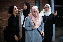 "© Licensed to London News Pictures. 05/06/2019. Manchester, UK. HADJER TAIBI (25 from Withington) , NAIMA BENYAHLOU (25 from Crumpsall), HALIMA BENZDIRA (27 from Withington) and DOUNIA (26 from Fallowfield) - who call themselves "" The Algerian Squad "" . People celebrate Eid-ul-Fitr , the end of a month of fasting during Ramadan , in Rusholme in Manchester . Photo credit: Joel Goodman/LNP"