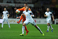 Swansea's Angel Rangel is tackled by Valencia's Juan Bernat. UEFA Europa league match, Swansea city v Valencia at the Liberty Stadium in Swansea on Thursday 28th November 2013. pic by Andrew Orchard, Andrew Orchard sports photography,