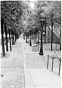 Black and white photo of the famous Montmartre staircase, Paris, France