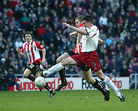 Photo. Andrew Unwin.<br /> Sunderland v Sheffield United, FA Cup Sixth Round, Stadium of Light, Sunderland 07/03/2004.<br /> Sheffield United's Chris Morgan (r) tries to stop another surging run from Sunderland's Kevin Kyle (c).