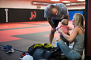 Coach Greg Jackson visits with UFC heavyweight Alistair Overeem's wife and daughter at Jackson Wink MMA in Albuquerque, New Mexico on June 9, 2016.