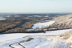 Licensed to London News Pictures. 13/01/2017. Woldingham, UK. Snow covers large swathes of the North Downs outside Woldingham in Surrey today (13/01/2017), after snow swept through parts of the UK yesterday. Further snow is predicted later today with many parts of the UK disrupted due to severe weather. Photo credit: Matt Cetti-Roberts/LNP