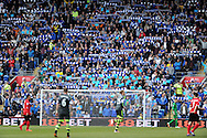 The Cardiff city fans hold up their blue scarves. Barclays Premier league match, Cardiff city  v Stoke city at the Cardiff city stadium in Cardiff, South Wales on Saturday 19th April 2014. pic by Andrew Orchard, Andrew Orchard sports photography,