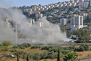 Heavy smoke is seen from a fire in the Haifa recycling facility. Haifa Bay, Israel