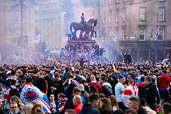 Glasgow, Scotland, UK. 15 May 2021. Thousands of supporters and fans of Rangers football club descend into George Square in Glasgow to celebrate winning the Scottish Premiership championship for the 55th time and the first time for 10 years.Iain Masterton/Alamy Live News