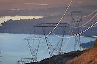 Power lines and transmission towers at sunset on Stewart Mountain near Bellingham, Washington Lake Whatcom is in the disatance