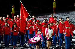 Isle of Man's flag bearer Jake Kelly leads the team out during the Opening Ceremony for the 2018 Commonwealth Games at the Carrara Stadium in the Gold Coast, Australia.