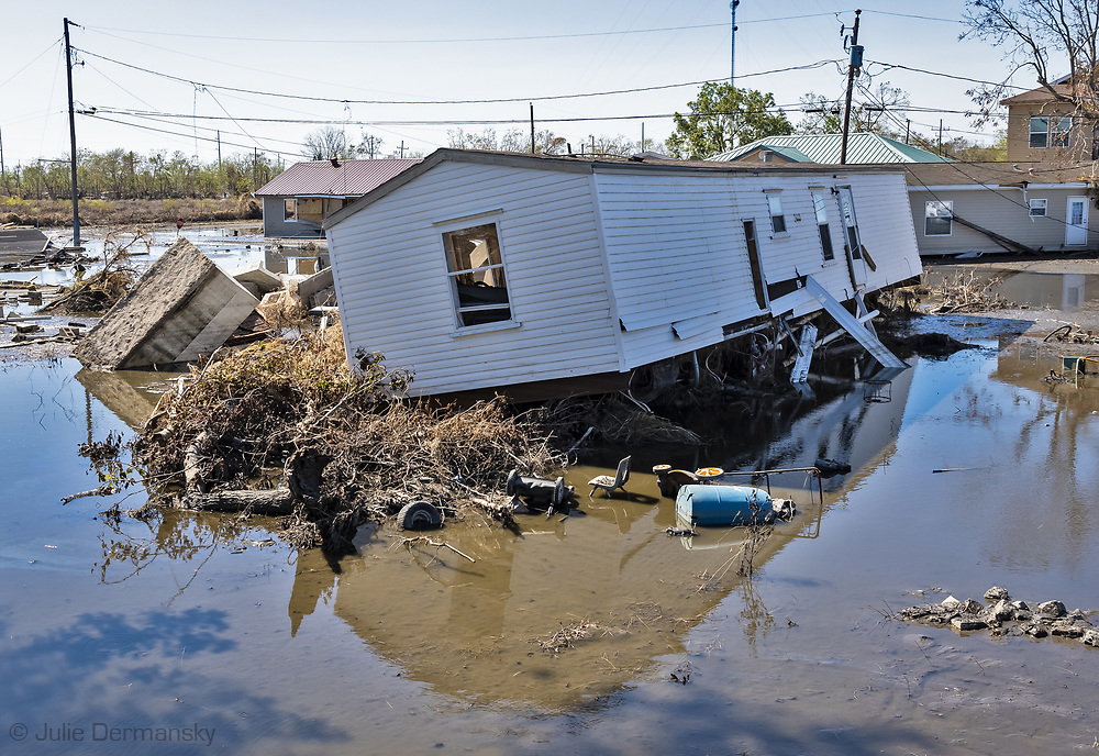 Tombs and house  dislodged by a storm surge in Ironton by Hurricane Ida.
