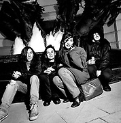My Bloody Valentine (Kevin Shields, Debbie Googe, Colm O'Ciosoig and Bilinda Butcher) photographed in the early 1990's.