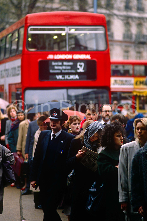 Queues of Londoners line up to gain a ride on a bus during a strike day of underground tube unions. Thousands are disrupted at Victoria station in central London, on their way to their inner-city destinations. The buses have a maximum capacity and too few seats for the commuters waiting patiently in line.